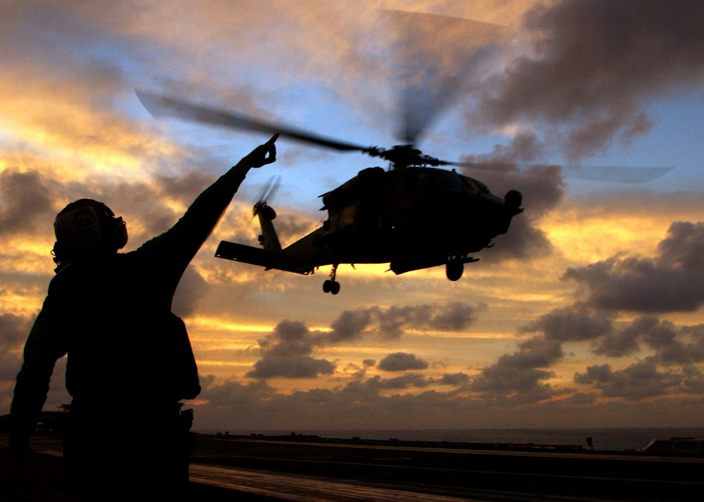 """041115-N-4757S-147 Arabian Sea (Nov. 15, 2004) - Aviation Electrician's Mate Airman John Broughton signals to an HH-60H Seahawk helicopter assigned to the """"Dusty Dogs"""" of Helicopter Anti-Submarine Squadron Seven (HS-7), as it takes-off from the flight deck aboard the Nimitz-class aircraft carrier USS Harry S. Truman (CVN 75). Truman and embarked Carrier Air Wing Three (CVW-3) are currently on a scheduled deployment in support of the Global War on Terrorism. U.S. Navy photo by Photographer's Mate 3rd Class Craig R. Spiering (RELEASED)"""